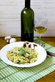 Pasta farfalle with pesto and mushrooms — Stock Photo