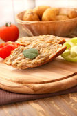 Slice of bread smeared with aubergine salad — Stock Photo