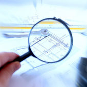 Magnifying glass and house plan — Stock Photo