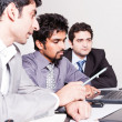 Three businessmen in a meeting — Stock Photo #11117976