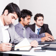 Three businessmen in a meeting — Stockfoto
