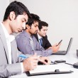 Three businessmen in a meeting - Stock Photo