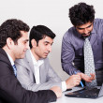 Постер, плакат: Three businessmen in a meeting