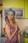 Funny portrait of the housewife in the kitchen — Stock Photo