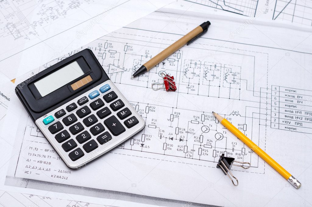 Electrical drawings with calculator, pencils and paper clips — Stock Photo #11114819