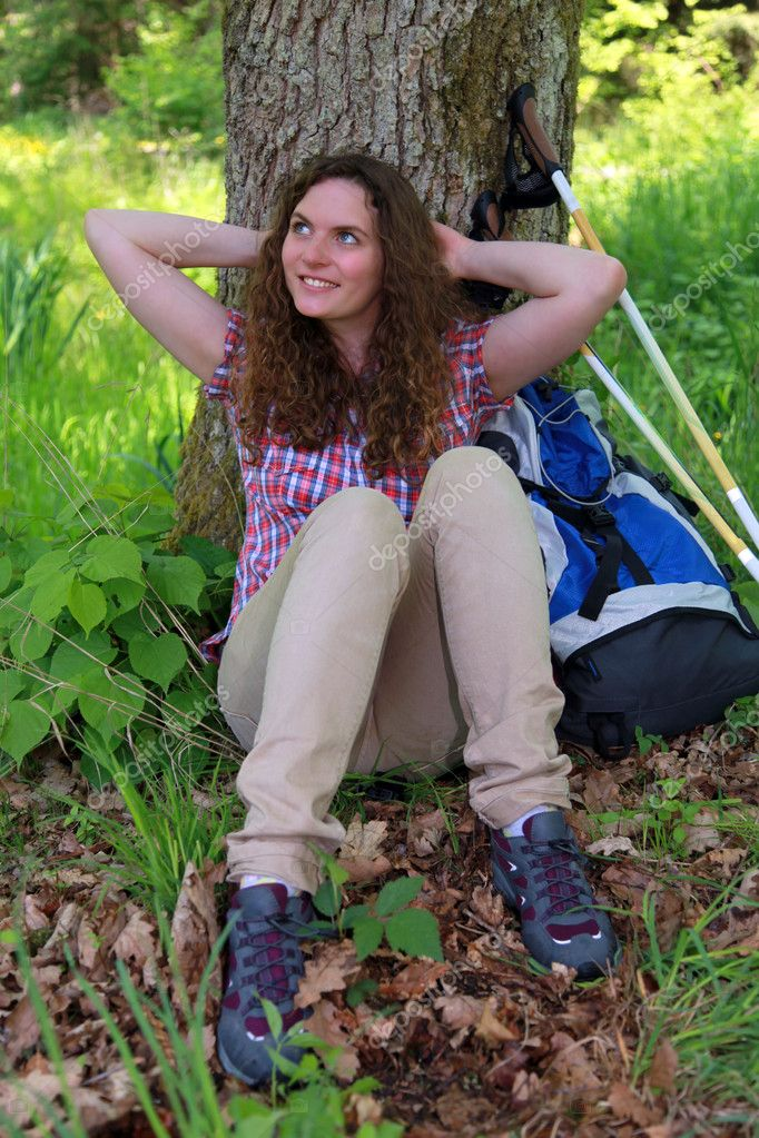 A young woman makes a short break during a Nordic Walking tour — Stock Photo #11739627