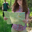 Stock Photo: Hiker is reading a map
