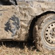 Mud covered car at race for survival — Stock Photo