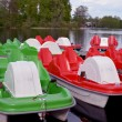 Stock Photo: Water bicycles green and red locked at lake pier