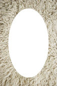 Na białym tle biały owalny w maty z wełny — Zdjęcie stockowe