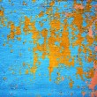 Royalty-Free Stock Photo: Background of peeling paint wall painted colors