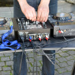 Dj hands play mix track turntable panel in street — Stock Photo #11305083