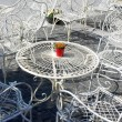 Decorative white tables and chairs outside cafe - Stock Photo