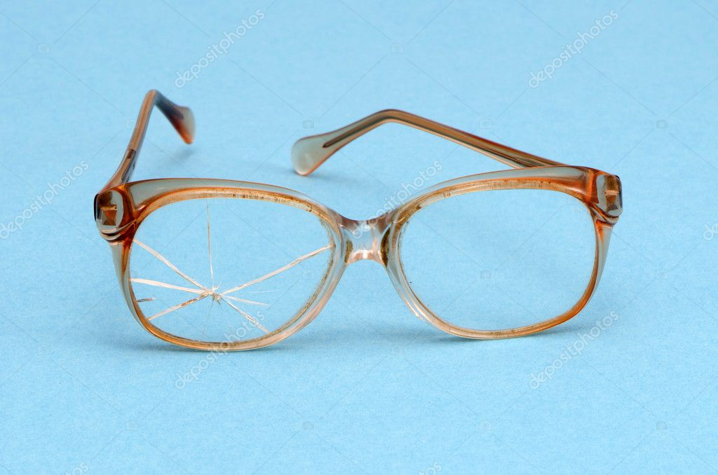 Old vintage retro galsses with broken left glass on blue background. — Stock Photo #11304903