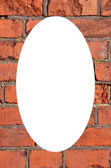 Red brick wall frame and isolated white oval — Stock Photo