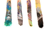 Dirty wooden paint brushes isolated on white — Stock Photo