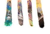 špinavé dřevěné štětce izolované na bílém — Stock fotografie
