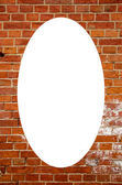 Red brick wall and white oval in center — Stock Photo