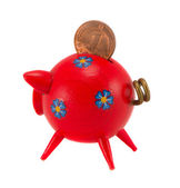 Red piggybank with pfennig isolated on white — Stock Photo