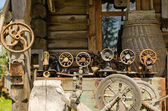Old sewing and weaving machines tools log house — Stock Photo