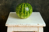 Watermelon healthy food nutrition on white painted old dirty wooden table. — Stock Photo