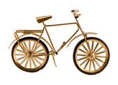 Small gold color toy bicycle isolated on white — Stock Photo