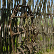Old corroded field harrow tool stand wooden fence — Stock Photo