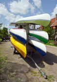 Kayaks canoes loaded on special transport trailer — Stock Photo