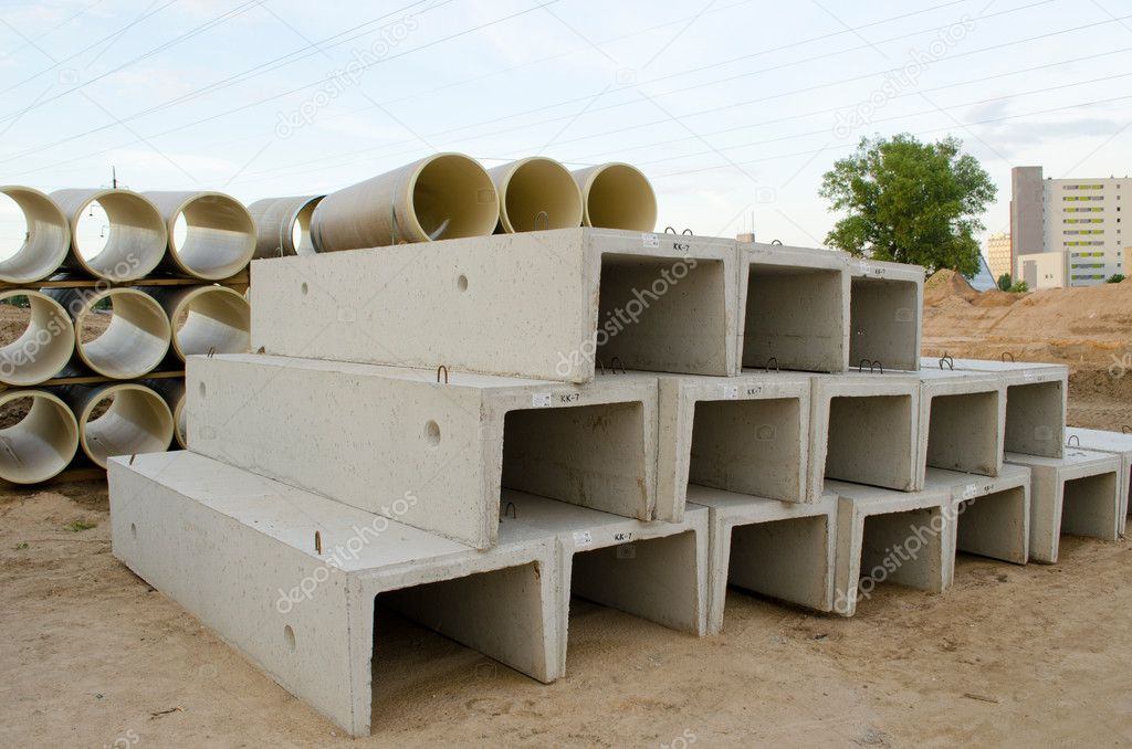 Materials used in road construction works. Concrete molds and plastic sewage pipes.  Stock Photo #11941507
