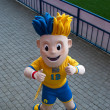 Stock Photo: Symbol of EURO 2012 Slavko poses on stadium