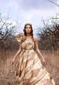 Princess in gold dress — Stock Photo
