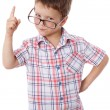 Stock Photo: Little boy in glasses with pointing hand