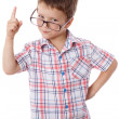 Little boy in glasses with pointing hand — Stock Photo