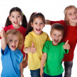 Group of children with thumbs up sign - Stock Photo