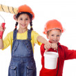 Kids in overalls with paint roller and paintbrush — Stock Photo #10985719