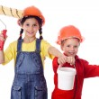 Kids in overalls with paint roller and paintbrush — Stock Photo