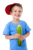 Smiling boy with cucumber — Stock Photo