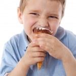 Squinting boy eating ice cream — Stock Photo #11094803