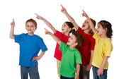 Group of children with pointing up sign — Stock Photo