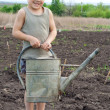 Little boy with old watering can — Stock Photo #11144763