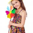 Smiling girl with colorful windmill — Stock Photo #11563731