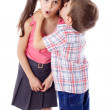 Little boy whispering something to girl — Stock Photo
