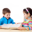 Two kids sharing the book — Stock Photo #11599758