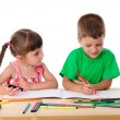 Stock Photo: Two little kids draw with crayons