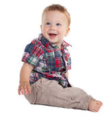 Smiling baby sitting on the floor — Stock Photo