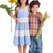 Two kids with sunflower and wheat — Stock Photo #11787156