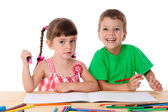 Two little kids draw with crayons — Photo