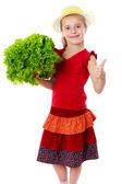 Jeune fille souriante avec salade de laitue — Photo