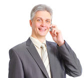 Handsome man posing with a phone — Stock Photo
