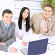 Royalty-Free Stock Photo: Young businesspeople discuss the new project at office.